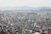 With a population of over 10 million Seoul is home to a quarter of South Korea's population and is bordered by eight mountains. Seoul, South Korea, 2007