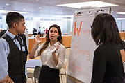 Purchase, NY – 31 October 2014. Saunders Trades and Technical High School student Gabriella Perez works on their presentation as Charlie Hernandez look son. On the right is Morgan Stanley facilitator Breeana Jones. The Business Skills Olympics was founded by the African American Men of Westchester, is sponsored and facilitated by Morgan Stanley, and is open to high school teams in Westchester County.