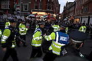 London 04/01/09: Protests outside the Israeli Embassy in London UK: A protester is led away after a minor scuffle with police