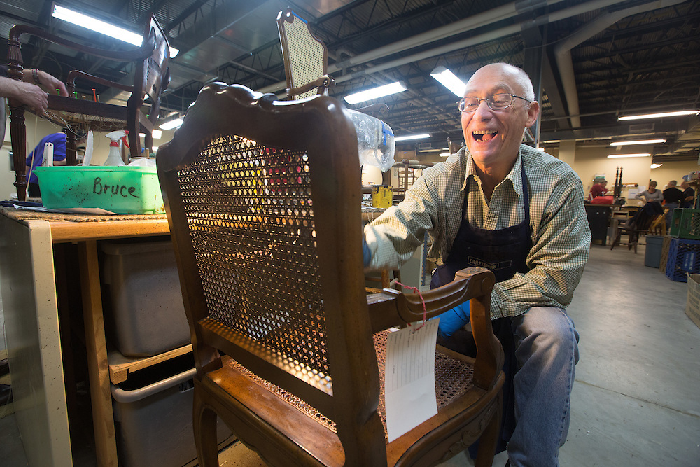 Bruce Stein of New Brunswick stains a chair at the Sage Eldercare furniture restoration workshop in Summit.  1/5/14 Photo by John O'Boyle