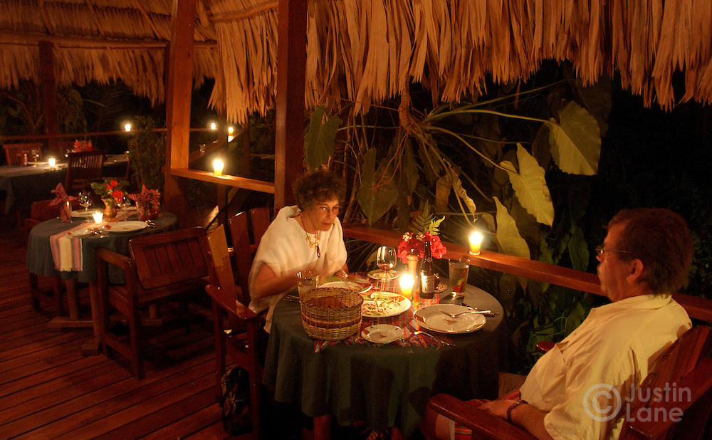 A couple eats dinner at the Blancaneaux Lodge, one of Francis Ford Coppola's resorts, in the eastern part of Belize.<br />JUSTIN LANE FOR THE NEW YORK TIMES