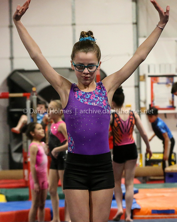 (2/6/18, HOPEDALE, MA) Grace Gorham, 12, of Milford, trains at McKeon Dance & Gymnastics in Hopedale on Tuesday. [Daily News and Wicked Local Photo/Dan Holmes]
