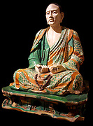 Statue of the seated arhat Tâmrabhadra. Buddhist priest in prayer Chinese, Liao dynasty (947-1125 A.D). Ceramic
