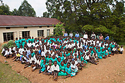 All the school children at Nyamiyaga Primary School. At the school the Bwindi Community Hospital run health outreach programs. As part of the outreach programme they cover 32 primary schools and 5 secondary schools in the region as well as many communities. The main Bwindi Community Hospital is in Buhoma village on the edge of the Bwindi Impenetrable Forest in Western Uganda. It serves around 60,000 people from the surrounding area.