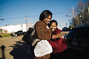 UNIONTOWN, AL – DECEMBER 11, 2019: Keshee Dozier-Smith (left), 34, hugs one of her nurses after an informational gathering for local police.<br /> <br /> Since joining Rural Health Medical Program as Chief Executive Officer in March 2016, Dozier-Smith has effectively moderned the 35-year-old floundering business – opening three new clinics, streamlining processes and reaching out to local companies to offer healthcare services for employees. In the wake of rising hospital closures that leave Alabama's poorest citizens disproportionately cut off from access to medical care, Dozier-Smith represents a renewed effort to bridge the rural gap by offering a quality, affordable healthcare option.