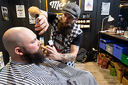 Barbers from Mootes worked the Swiss-Moto Customizing and Tuning Show. Zurich, Switzerland. Saturday, February 23, 2019. Photography ©2019 Michael Lichter.