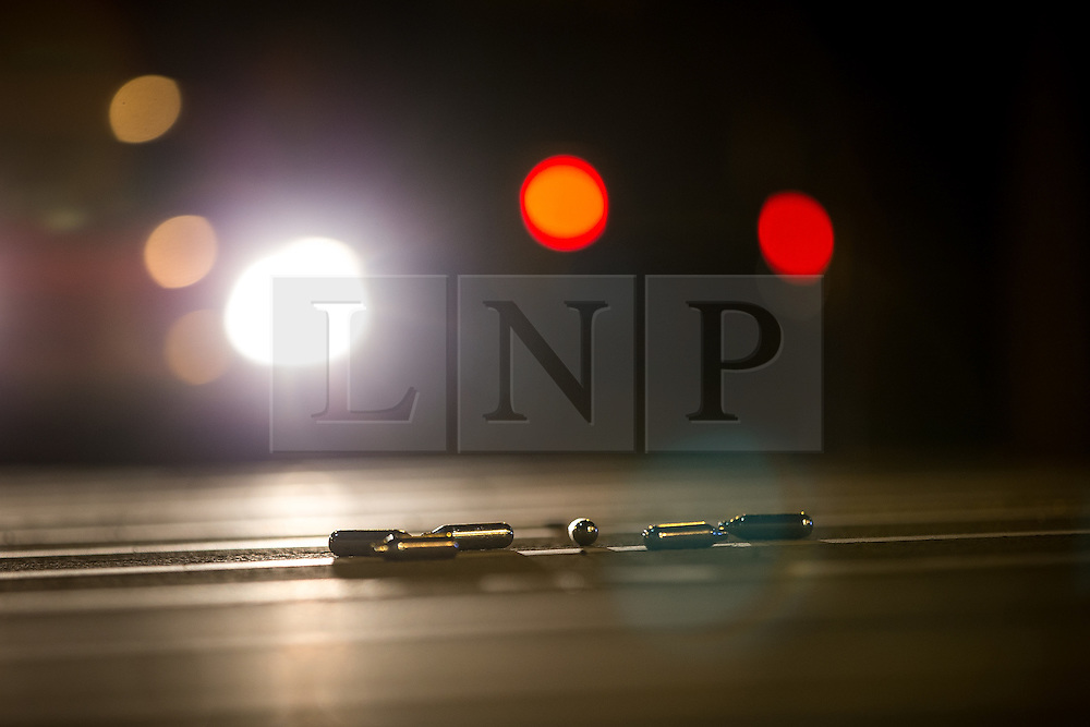 © Licensed to London News Pictures . 15/02/2016 . Manchester , UK . Discarded laughing gas canisters on the pavement in the city centre of Manchester , seen overnight on Valentine's Day evening . Photo credit : Joel Goodman/LNP