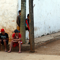 Central America, Cuba, Remedios. Cuban boys hanging out on a street corner in Remedios.