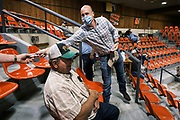"""22 SEPTEMBER 2020 - DUNLAP, IOWA: Congressional candidate J.D. SCHOLTEN campaigns at Dunlap Livestock Auction. Scholten, a Democrat from Sioux City, Iowa, ran against incumbent CongressmanSteve King (R-4th District Iowa) in 2018 and came within a few percentage points of upsetting the long serving conservative. King lost to Randy Feenstra, a Republican challenger, in the 2020 primary and Scholten is running against Feenstra in the 2020 general election on November 3. Iowa's 4th district, centered in the agricultural and sparsely populated northwest corner of the state, is the largest congressional district in Iowa and encompasses about ⅓ of the state of Iowa. Scholten is on his """"Every Town Tour 2020."""" He is visiting all 375 towns in the 39 counties in the district.    PHOTO BY JACK KURTZ"""