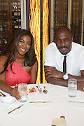 24 June 2010- Miami Beach, Florida-l to r: Kenya Moore and Idris Elba at the The 2010 American Black Film Festival Founder's Brunch held at Emeril's on June 24, 2010. Photo Credit: Terrence Jennings/Sipa