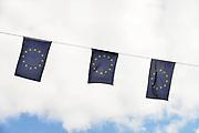 Duitsland, Germany, Kranenburg, 31-8-2017In Kranenburg, vlak over de grens met Nederland bij Nijmegen, hangen vlaggetjes van Europa bover de straat. Het zijn binnenkort verkiezingen in Duitsland.Foto: Flip Franssen