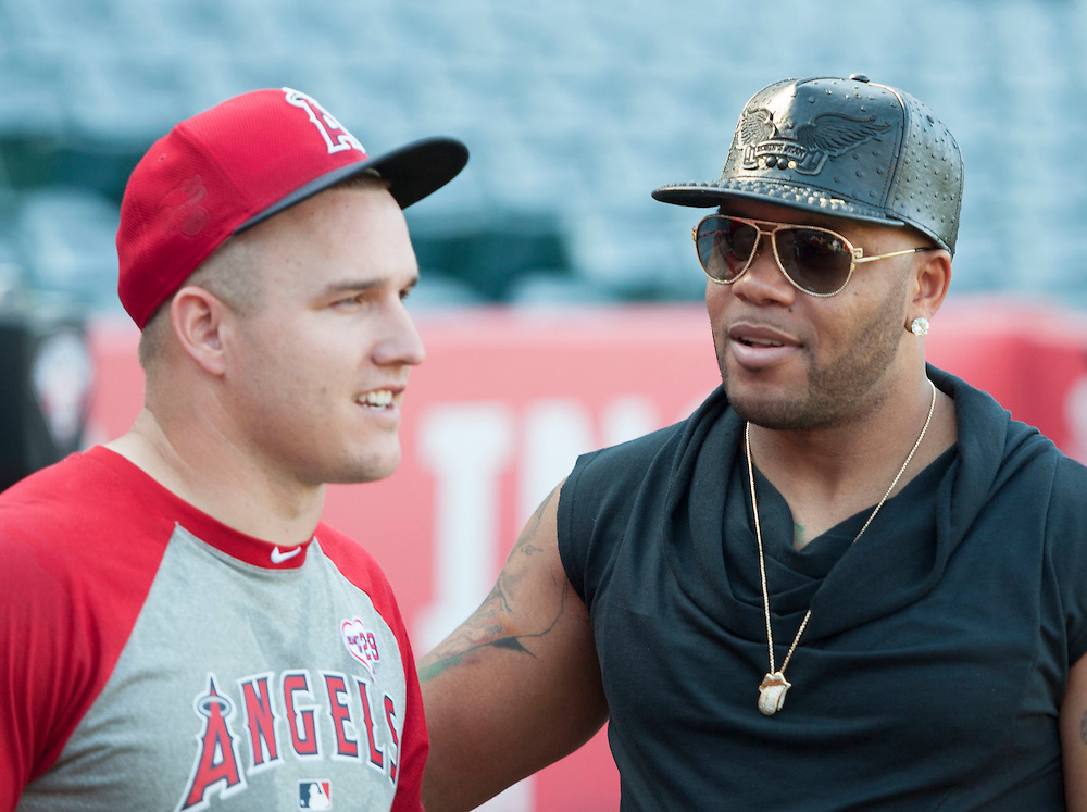 Flo Rida chats with Mike Trout before the Angels victory Tuesday night at Angel Stadium.<br /> <br /> ///ADDITIONAL INFO:   <br /> <br /> angels.0615.kjs  ---  Photo by KEVIN SULLIVAN / Orange County Register  -- 6/14/16<br /> <br /> The Los Angeles Angels take on the Minnesota Twins Tuesday at Angel Stadium.