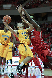 22 January 2014: Fred VanVleet reaches bak to loop a shot over John Jones during an NCAA Missouri Valley Conference mens basketball game between the Shockers of Wichita Stat and the Illinois State Redbirds  in Redbird Arena, Normal IL.