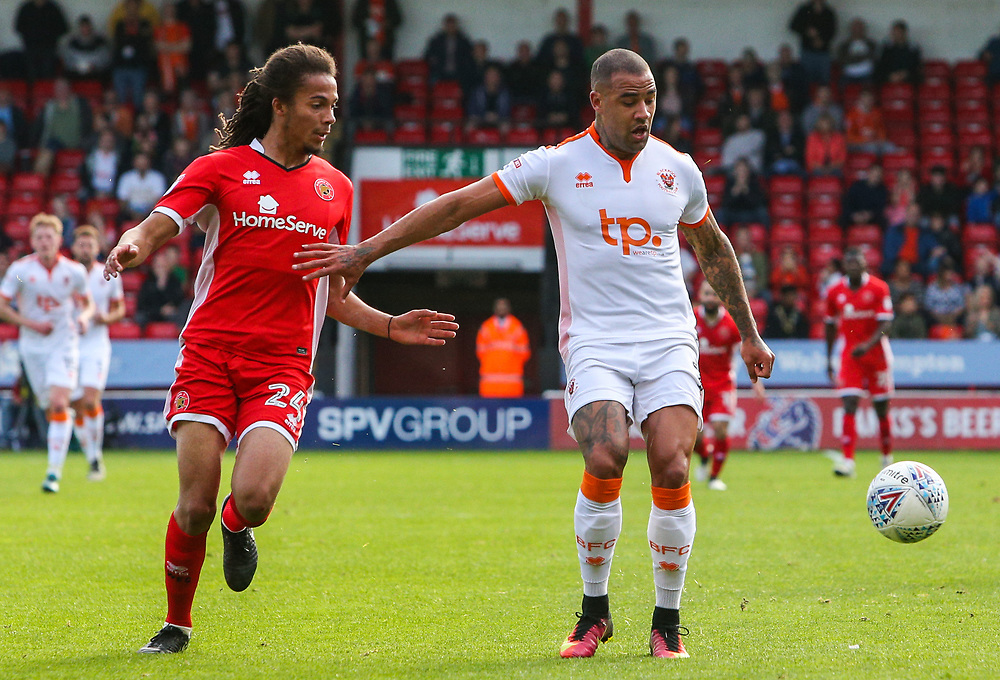 Blackpool's Kyle Vassell holds off the challenge from Walsall's Kory Roberts<br /> <br /> Photographer Alex Dodd/CameraSport<br /> <br /> The EFL Sky Bet League One - Walsall v Blackpool - Saturday 14th October 2017 - Bescot Stadium - Walsall<br /> <br /> World Copyright © 2017 CameraSport. All rights reserved. 43 Linden Ave. Countesthorpe. Leicester. England. LE8 5PG - Tel: +44 (0) 116 277 4147 - admin@camerasport.com - www.camerasport.com
