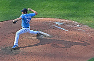 Kansas City Royals relief pitcher Greg Holland (35) delivers a pitch during the eighth inning against the Minnesota Twins at Kauffman Stadium.