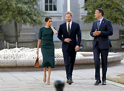 The Duke and Duchess of Sussex with Taoiseach, Leo Varadkar (right) as they arrive at Government Buildings during their visit to Dublin, Ireland.
