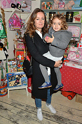 LUCY YEOMANS and her daughter RED at a promotional party for the A Girl For All Time doll held at HoneyJam, 2 Blenheim Crescent, London on 5th December 2015.