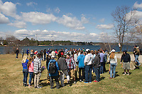 Friends and family gather along Lake Opechee Saturday afternoon for a memorial gathering in memory of Lily Johnson.  (Karen Bobotas/for the Laconia Daily Sun)