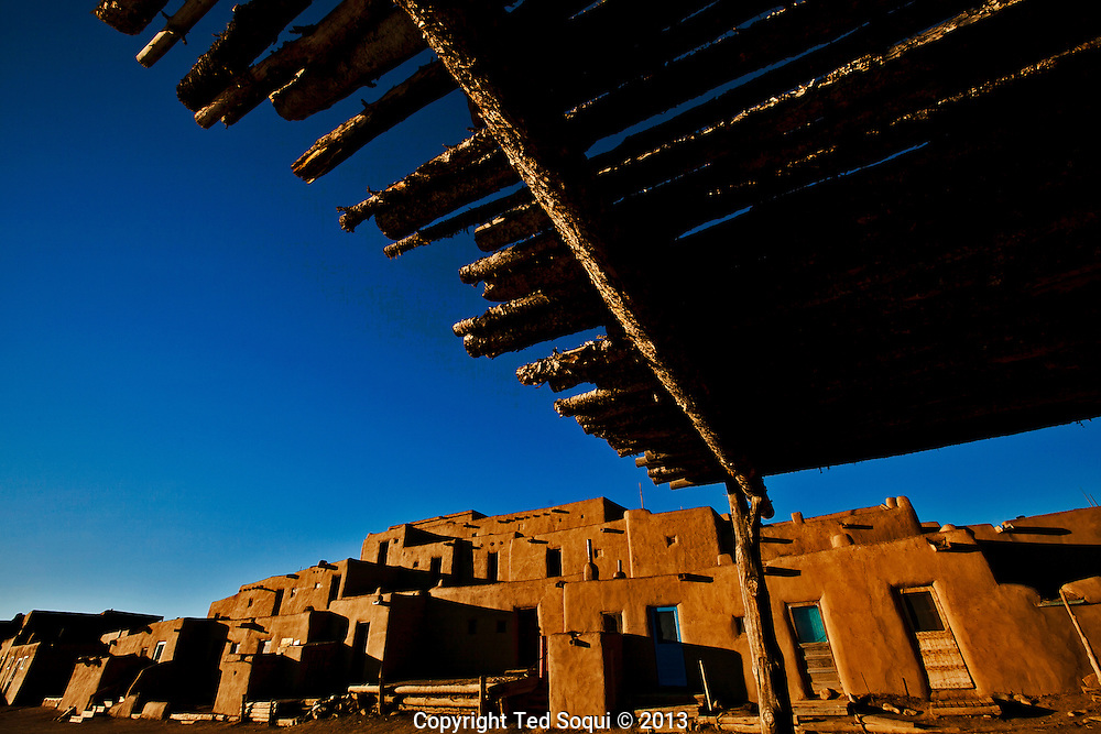 Winter in New Mexico..An adobe structure at the Taos Pueblo. Parts of the Pueblo date back to 1619.