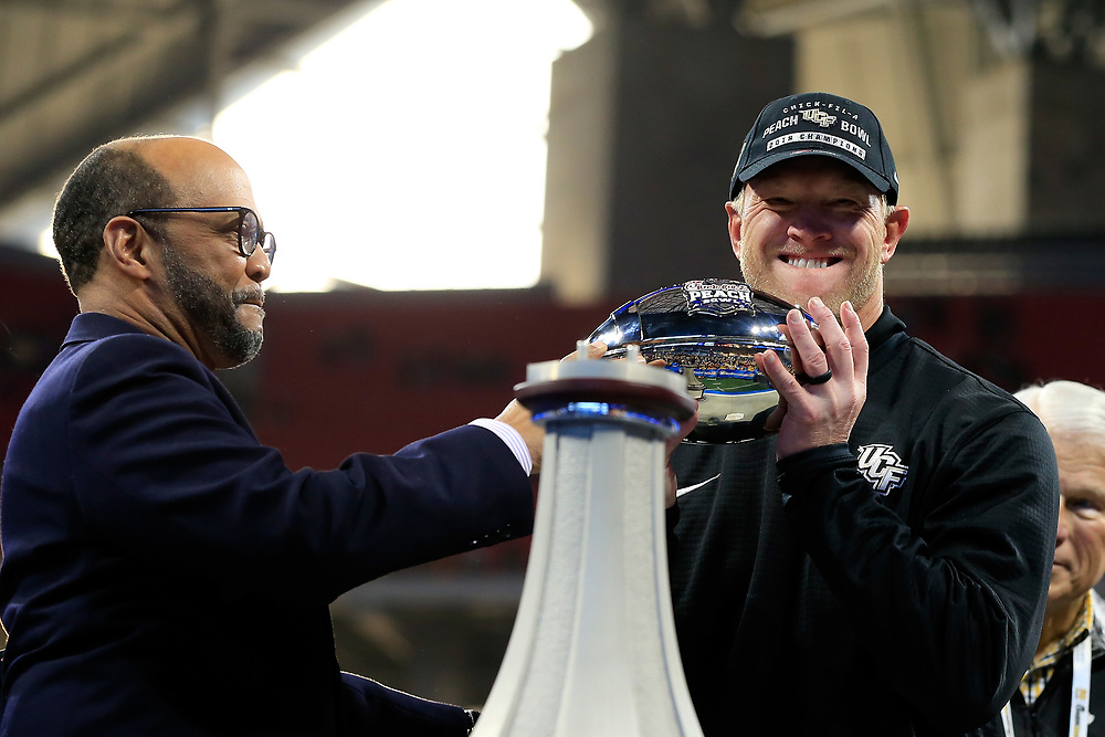 UCF Knights head coach Scott Frost celebrates beating the Auburn Tigers during the 2018 Chick-fil-A Peach Bowl NCAA football game on Monday, January 1, 2018 in Atlanta. The UCF Knights won 34-27. (Paul Abell / Abell Images for the Chick-fil-A Peach Bowl)
