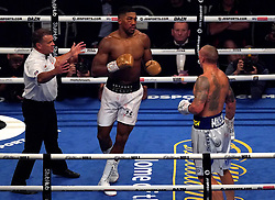 Anthony Joshua with a bruised eye in the 11th round against Oleksandr Usyk in the WBA, WBO, IBF and IBO World Heavyweight titles match at the Tottenham Hotspur Stadium. Picture date: Saturday September 25, 2021.