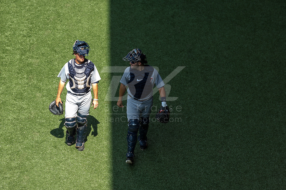 Alex Avila (13) of the Detroit Tigers and the Detroit Tigers bullpen catcher walk in the bullpen before a game against the Minnesota Twins on August 15, 2012 at Target Field in Minneapolis, Minnesota.  The Tigers defeated the Twins 5 to 1.  Photo: Ben Krause
