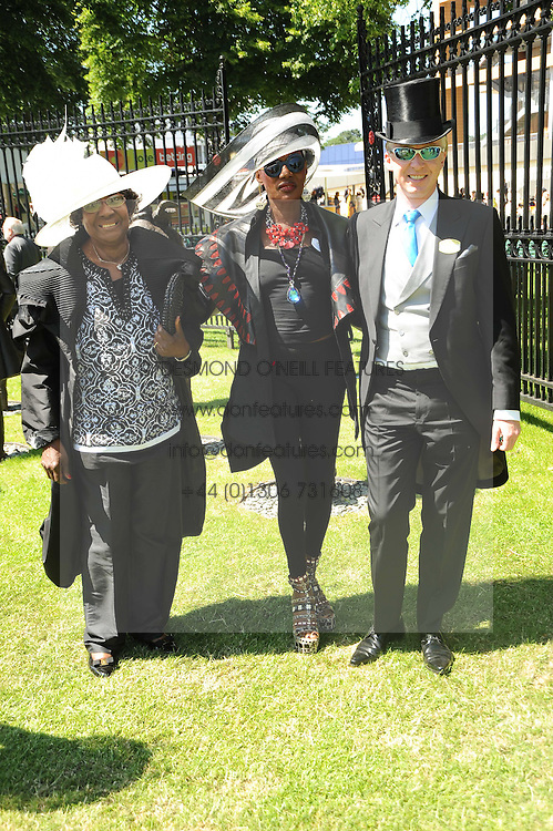 Left to right, MARJORIE JONES, GRACE JONES and PHILIP TREACY at the second day of the 2010 Royal Ascot Racing festival at Ascot Racecourse, Berkshire on 16th June 2010.