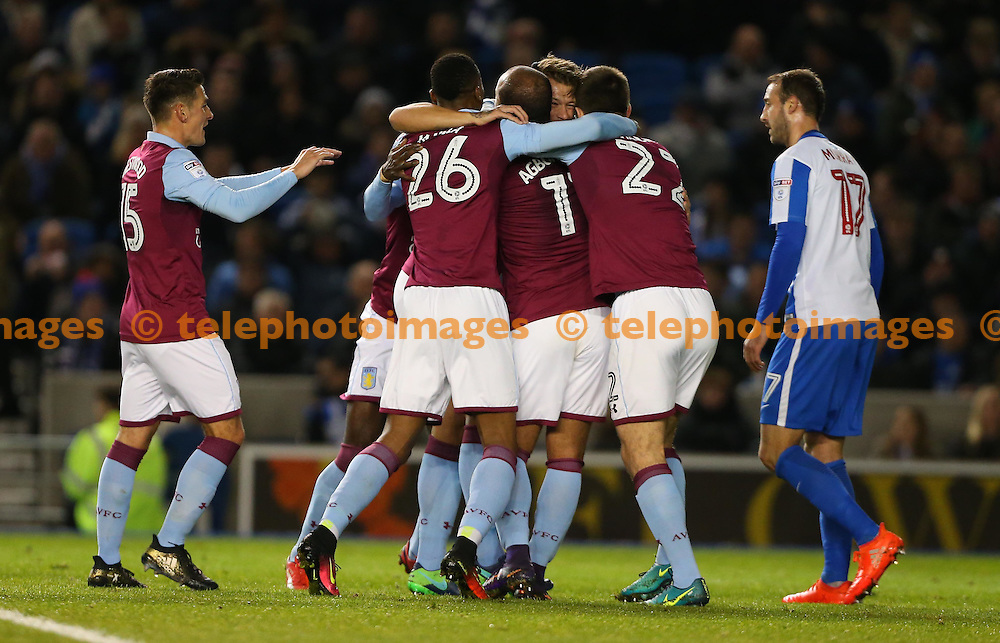 Nathan Baker of Aston Villa  celebrates after scoring during the Sky Bet Championship match between Brighton and Hove Albion and Aston Villa at the American Express Community Stadium in Brighton and Hove. November 18, 2016.<br /> James Boardman / Telephoto Images<br /> +44 7967 642437