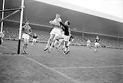 All Ireland Senior Football Final, 22nd September, 1963.Dublin V Galway..Dublin Full Back L. Foley catchs a high ball near own goalmouth and returns to earth with Galway Full Forward S. Cleary on right ..22.09.1963  22nd September 1963