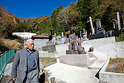 Yoshifumi Yamada, 84, chairman of Lake Shouji Touism Association, walks through a cemetery in which the remains of unidentifiable suicide victims are interred   near Aokigahara Jukai, better known as the Mt. Fuji suicide forest, which is located at the base of Japan's famed mountain west of Tokyo, Japan on 03 Nov. 2009...
