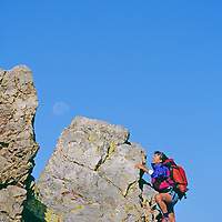 Martha Bellisle scrambles up ridge on Boundary Peak in White Mountains, California.