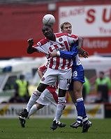Photo. Glyn Thomas.<br /> Sheffield United v Colchester. FA Cup fifth round.<br /> Bramall Lane, Sheffield. 15/02/2004.<br /> Sheffield's Wayne Allison (L) battles for the ball with Colchester's Liam Chilvers.