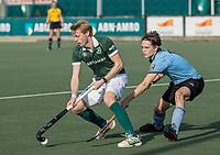 WASSENAAR - Jochem Bakker (Rotterdam) met Pelle Vos (HGC)  tijdens de hoofdklasse competitiewedstrijd heren, HGC-HC ROTTERDAM (0-7) .     COPYRIGHT  KOEN SUYK