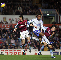 Photo: Paul Thomas.<br /> Aston Villa v Chelsea. The Barclays Premiership. 02/01/2007.<br /> <br /> Didier Drogba (White) of Chelsea is stuck between Liam Ridgewell (L) and Craig Gardner.