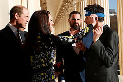 The Duchess of Cambridge adjusts Jon Salmon's headband at the Institute of Contemporary Arts in London where she and the Duke of Cambridge and Prince Harry were outlining the next phase of their mental health Heads Together campaign.