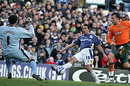 Coca Cola championship,Cardiff city v Plymouth Argyle at Ninian Park in Cardiff on Sunday 28th December 2008. pic by Andrew Orchard, Andrew Orchard sports photography. Michael Chopra of Cardiff City tries to shoot past Plymouth goalkeeper Romain Larrieu.
