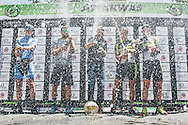 The 2017 Attakwas Extreme MTB Challenge men's podium finishers douse the crowd in sparkling wine. From left to right: HB Kruger (5th), Karl Platt (3rd), Christoph Sauser (1st), Kristian Hynek (2nd) and Erik Kleinhans (4th). Photo by: Ewald Sadie/Dryland/SPORTZPICS