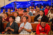 "12 JULY 2012 - FT DEFIANCE, AZ:     People pray in the main tent at the 23rd annual Navajo Nation Camp Meeting in Ft. Defiance, north of Window Rock, AZ, on the Navajo reservation. Preachers from across the Navajo Nation, and the western US, come to Navajo Nation Camp Meeting to preach an evangelical form of Christianity. Evangelical Christians make up a growing part of the reservation - there are now more than a hundred camp meetings and tent revivals on the reservation every year. The camp meeting in Ft. Defiance draws nearly 200 people each night of its six day run. Many of the attendees convert to evangelical Christianity from traditional Navajo beliefs, Catholicism or Mormonism. ""Camp meetings"" are a form of Protestant Christian religious services originating in Britain and once common in rural parts of the United States. People would travel a great distance to a particular site to camp out, listen to itinerant preachers, and pray. This suited the rural life, before cars and highways were common, because rural areas often lacked traditional churches.   PHOTO BY JACK KURTZ"