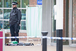 Licensed to London News Pictures. 16/10/2020. London, UK. Police guard a crime scene at Surrey Quays Shopping Centre, east London where a teenager, 18 has been stabbed and rushed to hospital by London Ambulance Service. Met police say they were called to reports of an assault. The teenager's condition is not yet known. Photo credit: Marcin Nowak/LNP