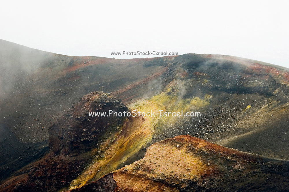 Smoke and steam emitted from Torre di Filosofo at 2920 meters, erupted 2003, with iron and sulfur deposits still visible, on the Southern slopes of Mount Etna, The highest and most active volcano in Europe, Nicolosi, Sicily, Italy July 2006