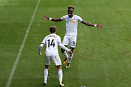 Tammy Abraham of Swansea city (10) celebrates with his teammate Tom Carroll after he scores his teams 1st goal. Premier league match, Swansea city v Huddersfield Town at the Liberty Stadium in Swansea, South Wales on Saturday 14th October 2017.<br /> pic by  Andrew Orchard, Andrew Orchard sports photography.