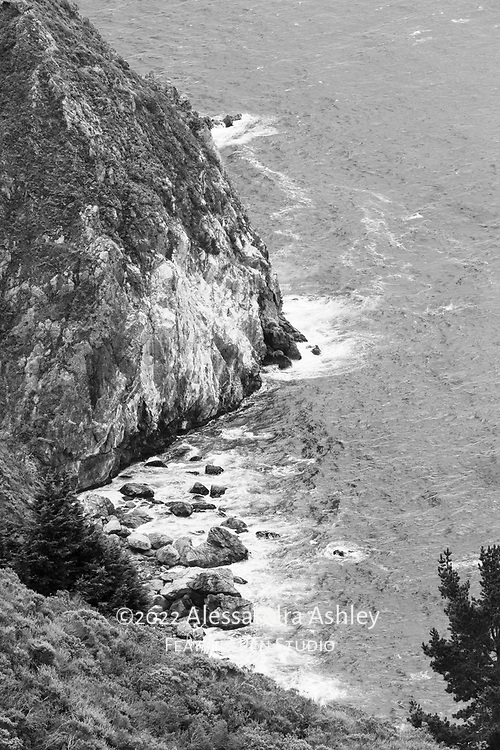 Cliffside view of the rugged Pacific coastline at Big Sur, California. Black and white rendering.