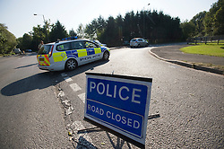 © Licensed to London News Pictures. Lingfield, UK  03/10/2011.  A road closed by police at the entrance to Hobbs industrial estate in Lingfield, Surrey where eight people have been injured in a factory explosion today (03/10/2011).  Photo credit: Ben Cawthra