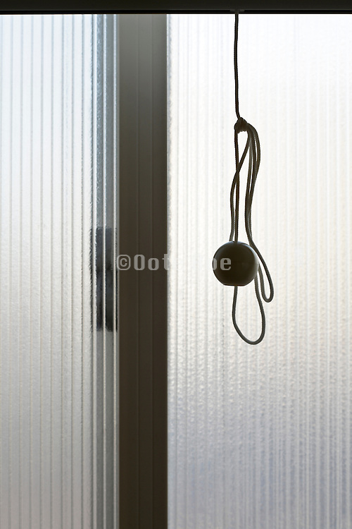 close up of window pane with handle of the roller screen
