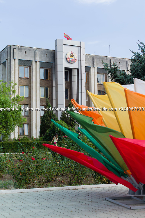 20150829  Moldova, Transnistria,Pridnestrovian Moldavian Republic (PMR) Dubushari.City hall building decorated with flags in all colors, prepared for the 25th indepence day on the 2nd of September.