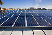 With Proposition B, in Los Angleles, the city's Department of Water and Power (DWP) will place solar photovoltaic systems throughout the city and connect them to the city's existing electrical grid. A roof mounted, grid tied Solar Voltaic solar panel array (10Kw), installed by Martifer Solar USA on top of the Santa Monica Library. The Library was built in 2005 by the architecture firm Moore Ruble Yudell (MRY) and is a LEEDS Certified building. Los Angeles County, California, USA