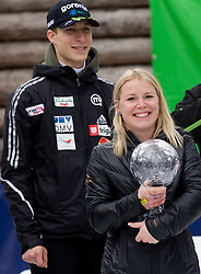 Jurij Tepes of Slovenia and Spela Vidic Kranjec with Trophy of her husband KRANJEC Robert (SLO), overall Skiflying World Cup Champion after the Flying Hill Individual competition at 4th day of FIS Ski Jumping World Cup Finals Planica 2012, on March 18, 2012, Planica, Slovenia. (Photo by Vid Ponikvar / Sportida.com)
