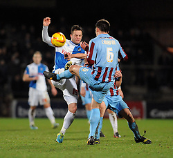 Bristol Rovers' Chris Beardsley challenges Scunthorpe United's Niall Canavan for the ball - Photo mandatory by-line: Dougie Allward/JMP - Tel: Mobile: 07966 386802 25/02/2014 - SPORT - FOOTBALL - Scunthorpe - Glanford Park - Scunthorpe United v Bristol Rovers - Sky Bet League Two