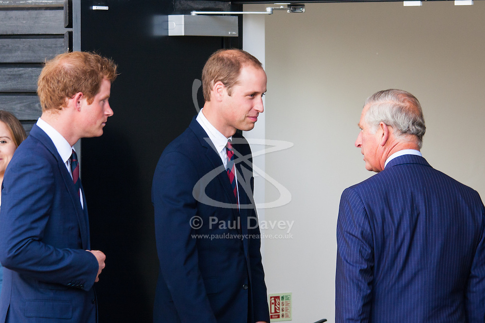 Queen Elizabeth Olympic Park, London, September 10th 2014. Princes Harry and William greet their father Prince Charles as he arrives at the opening ceremony  of the Invictus Games, where over 400 competitors from 13 nations will take part in an international sporting event for wounded, injured and sick Servicemen and women.