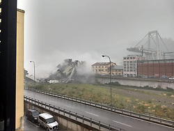 August 14, 2018 - Genoa, Italy - A highway bridge has partially collapsed near Genoa Italy, prompting fears of injuries and deaths. (Credit Image: © La Repubblica/Ropi via ZUMA Press)